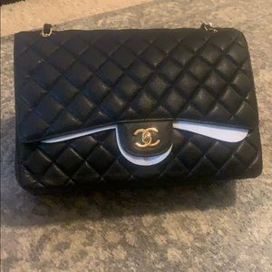 Used black w/gold hw Chanel maxi handbag.